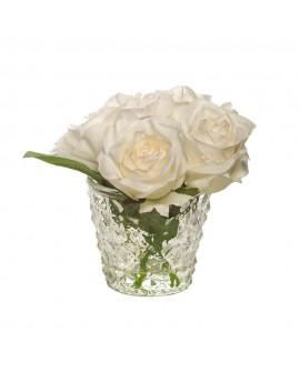 Rosas blancas en vaso de cristal pequeño